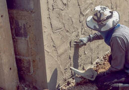 stucco contractor working on the exterior walls